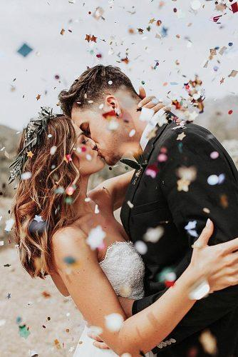unique wedding reception ideas newlyweds kissing and confetti