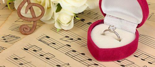 wedding reception songs ring notes flowers featured