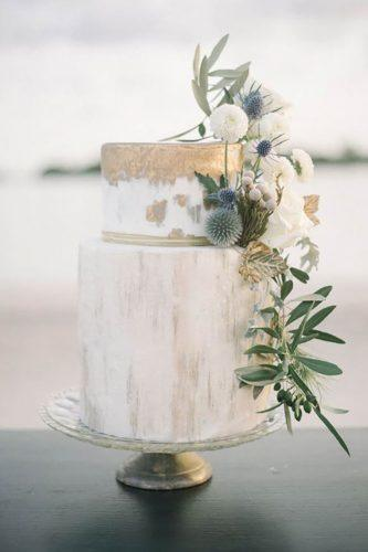 chic wedding cakes with golden touch and flowers blackbird photo