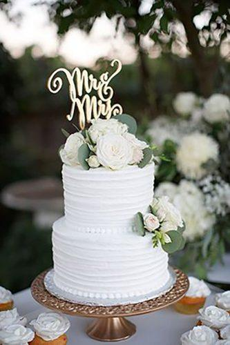 chic wedding cakes with white roses and greenery