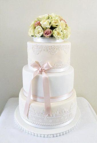 simple elegant chic wedding cakes white cake with flower bouquet nikhitacakes