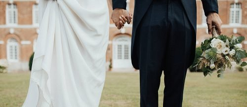 types of wedding newlyweds holding hands featured
