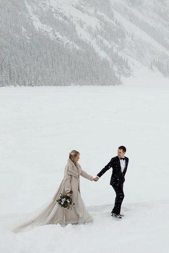 winter wedding bride and groom near mountains
