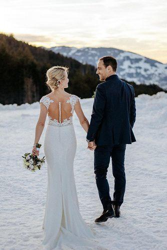 winter wedding couple together at the snow