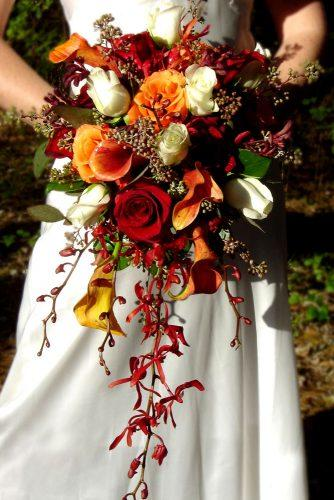 cascading wedding fall bouquet with orange burgundy -red-flowers