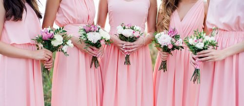 bridesmaid etiquette girls in blush bridesmaids dresses