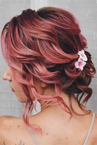 hottest bridesmaids hairstyles ideas curly low upgo on pink hair with pink flowers juliapopovamuah