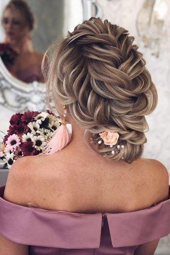 hottest bridesmaids hairstyles ideas low updo with french braids decorated with pink flowers babaevski
