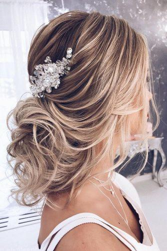 hottest bridesmaids hairstyles ideas messy low curly updo with crystal hairpin elstilespb