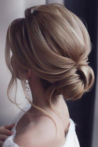 hottest bridesmaids hairstyles ideas simple elegant low blonde bun tonyastylist