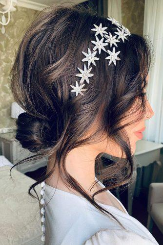 hottest bridesmaids hairstyles ideas slightly messy low bun with loose curls ang stars halo silviyahairstyling