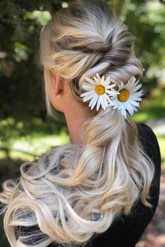 hottest bridesmaids hairstyles ponytail on long blonde hair decorated with chamomile annette_updo_artist