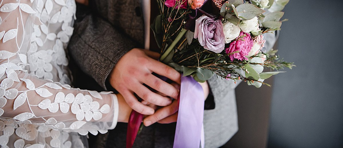 simple wedding ideas newlyweds with bouquet featured