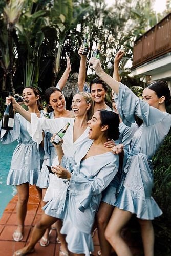 happy bridesmaids bride and bridesmaids drinking champagne