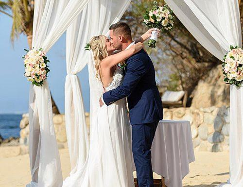 how to plan an outdoor wedding beach ceremony couple