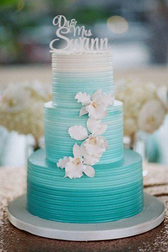buttercream wedding cakes three tired white and blue ombre decorated with orchids j wilkinson co photography