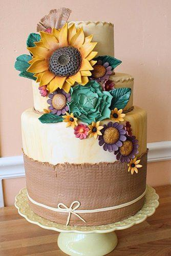fall wedding cakes beige with burlap of sunflowers succulents and other flowers oakleaf cakes bake shop via instagram
