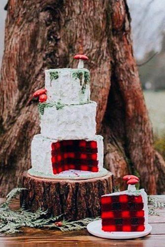 fall wedding cakes three tiered cake a white cake with fly agarics inside a black red cage erin shepley via instagram
