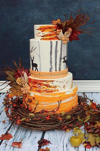 fall wedding cakes with deer decorated with yellow leaves and branches viva la cake via instagram
