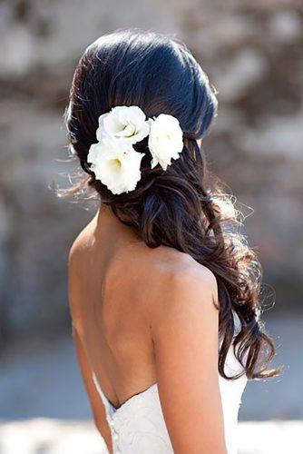 wedding hairstyles with white flower accessories