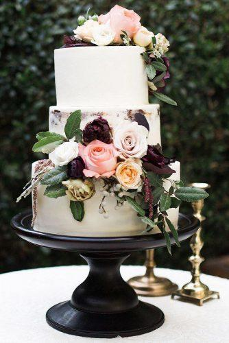 rustic wedding cakes buttercream white with roses and leaves pêche petite boutique bakery via instagram