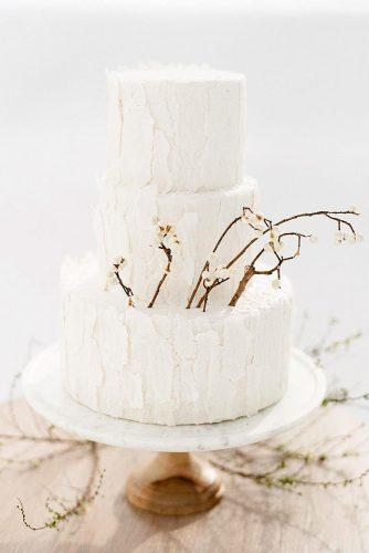 rustic wedding cakes buttercrean with small white flowers on branches meganjoycakes via instagram