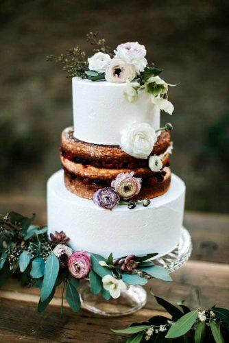 rustic wedding cakes half white buttercream half naked with garden flowers schultz photography