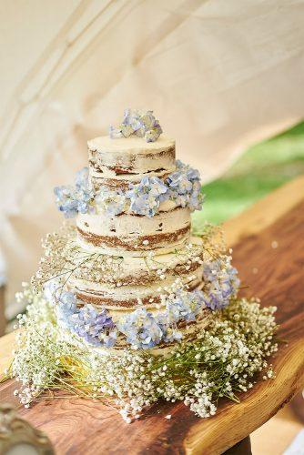 rustic wedding cakes nacked cake with wildflowers joshua lawrence