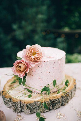 rustic wedding cakes romantic pink with flowers on wooden slice jessica janae via instagram