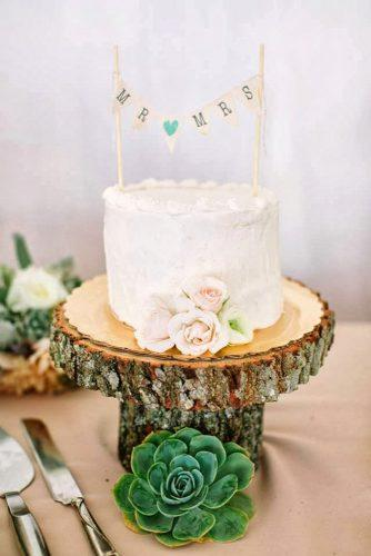rustic wedding cakes white buttercream vith roses on woodland stand carmen holt photography