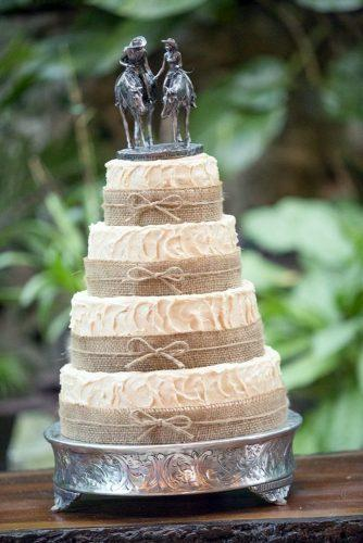 rustic wedding cakes white buttercream with burlap and cake topper bride with groom on horses atappen photography