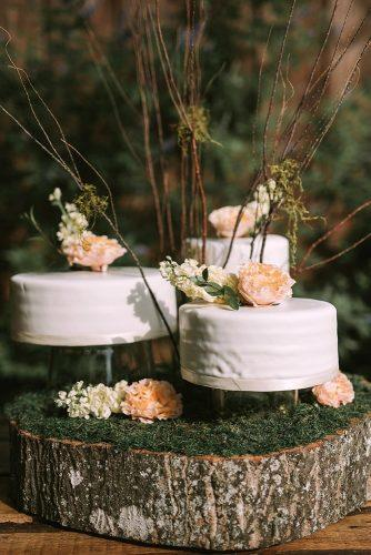 rustic wedding cakes white with flowers decorated with branches on wood and moss swak photography