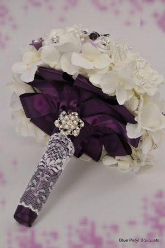 brooch wedding bouquets with purple ribbons and cristals