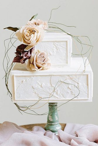 wedding cakes pictures frame white with textural sheets and branches larissa cleveland photography via instagram
