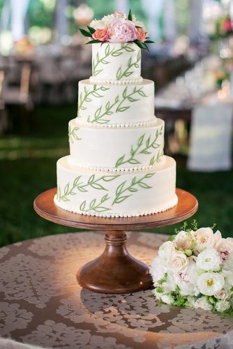 wedding cakes pictures white with green branches and flowers alexa stutts via instagram
