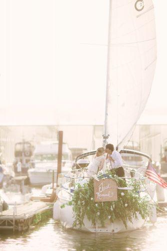 wedding exit photo ideas boat with green leave Red Boat Photography