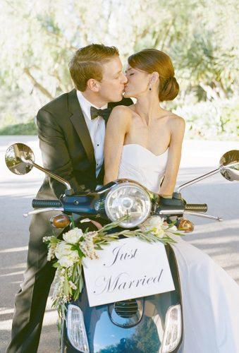 wedding exit photo ideas coach kiss couple scooter with sign aaron delesie