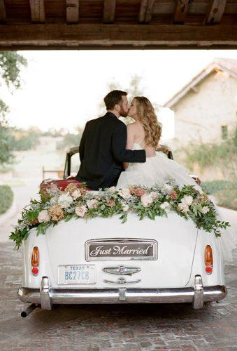 wedding exit photo ideas couple kiss in car davywhitener