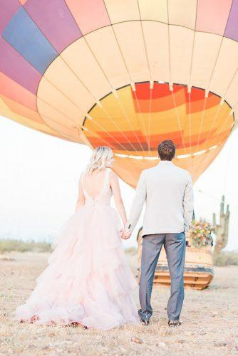 wedding exit photo ideas couple with ballon backview Jen Jinkens Photography