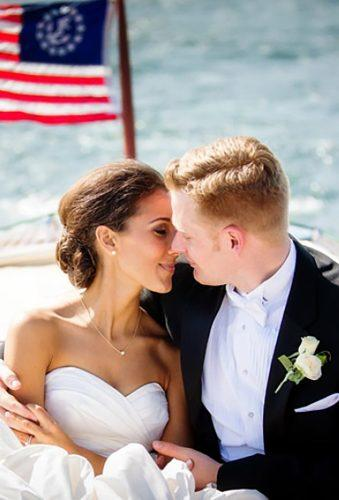 wedding exit photo ideas tender kiss boat with flag traceybuyce