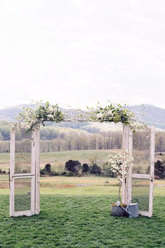 old door wedding decoration country style wide doorway with white transparent doors decorated with white flowers adam barnes fine art photography