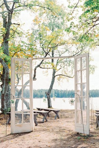 old door wedding decoration minimum adornments airy white doors with glass wedding on the river bank isabelle hesselberg via instagram