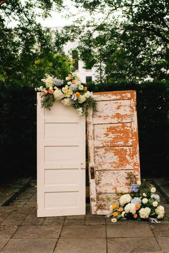 old door wedding decoration white vintage and flowers wedding background jeanne mitchum photography