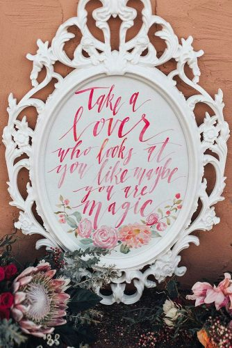 rustic wedding signs on a white background in an openwork frame a romantic inscription and pink flowers courtney larsen via instagram
