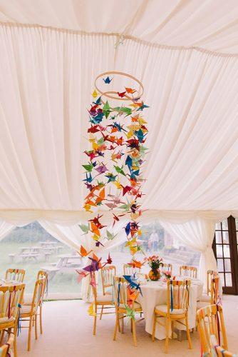 wedding decor trends reception under white tent decorated with bright origami pnm weddings