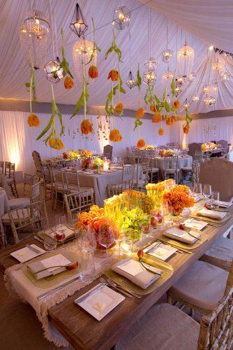 wedding decor trends reception under white tent decorated with suspended tulips and lanterns mindy weiss