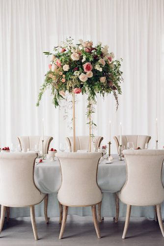 tall wedding centerpieces a minimalistic golden stand with greens and roses white and pink danielle defiore