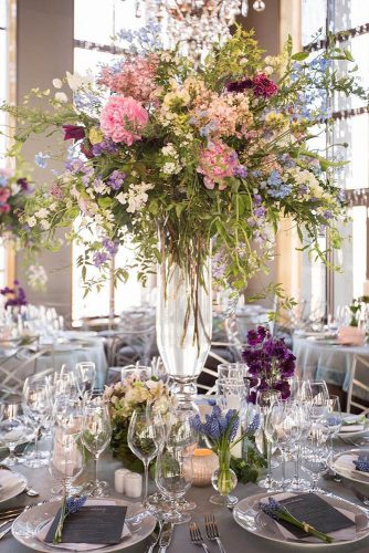tall wedding centerpieces chic wild flowers pink peonies and greens in a transparent vase ira lippke studios