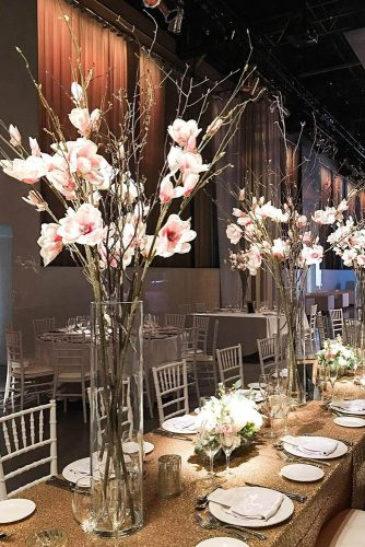 tall wedding centerpieces in a clear even vase wooden branches with pink flowers delight floral design via instagram