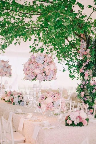tall wedding centerpieces on a thin stand soft delicate lilac and pink flowers of pastel tones katie stoops via instagram